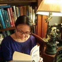 Photo of Glaiza reading Kafka on the shore by Haruki Murakami indoors